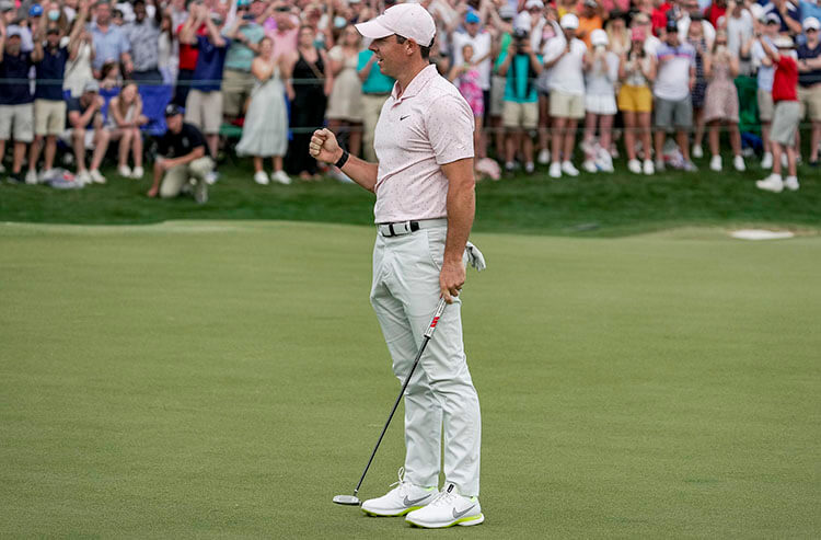 Rory McIlroy gives a fist bump after securing his third Wells Fargo championship during the final round of the Wells Fargo Championship golf tournament. - Jim Dedmon-USA TODAY Sports