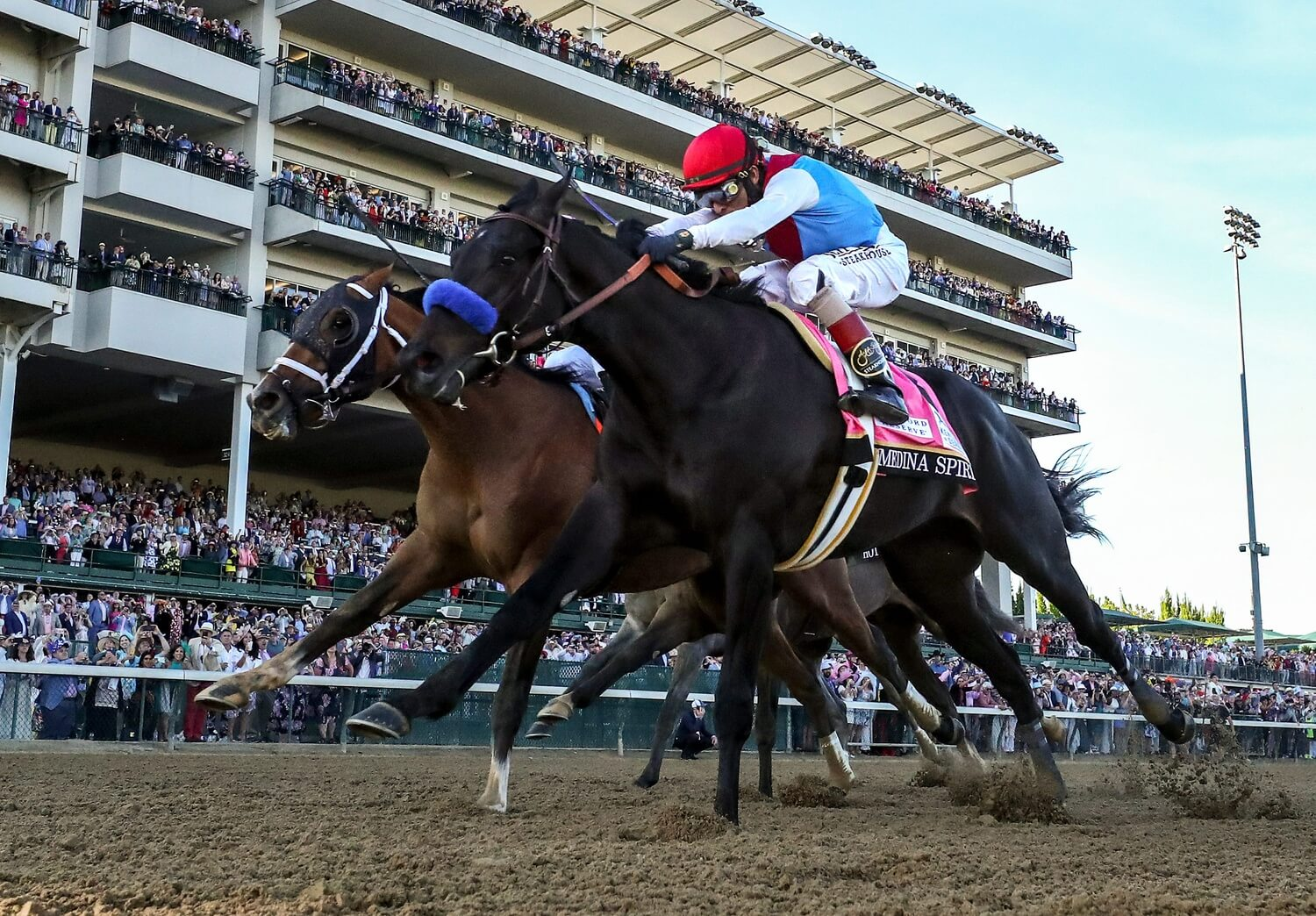John Velazquez aboard Medina Spirit (8) leads the field down the stretch to win the 147th running of the Kentucky Derby at Churchill Downs. . - Louisville Courier Journal-USA TODAY Sports