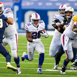 Buffalo Bills running back Devin Singletary (26) runs with the ball against the Los Angeles Chargers during the fourth quarter at Bills Stadium.