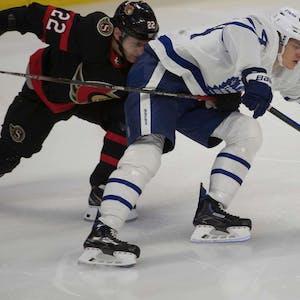 Ottawa Senators defenseman Nikita Zaitsev (22) hooks Toronto Maple Leafs center David Kampf (64) in the third period at the Canadian Tire Centre.