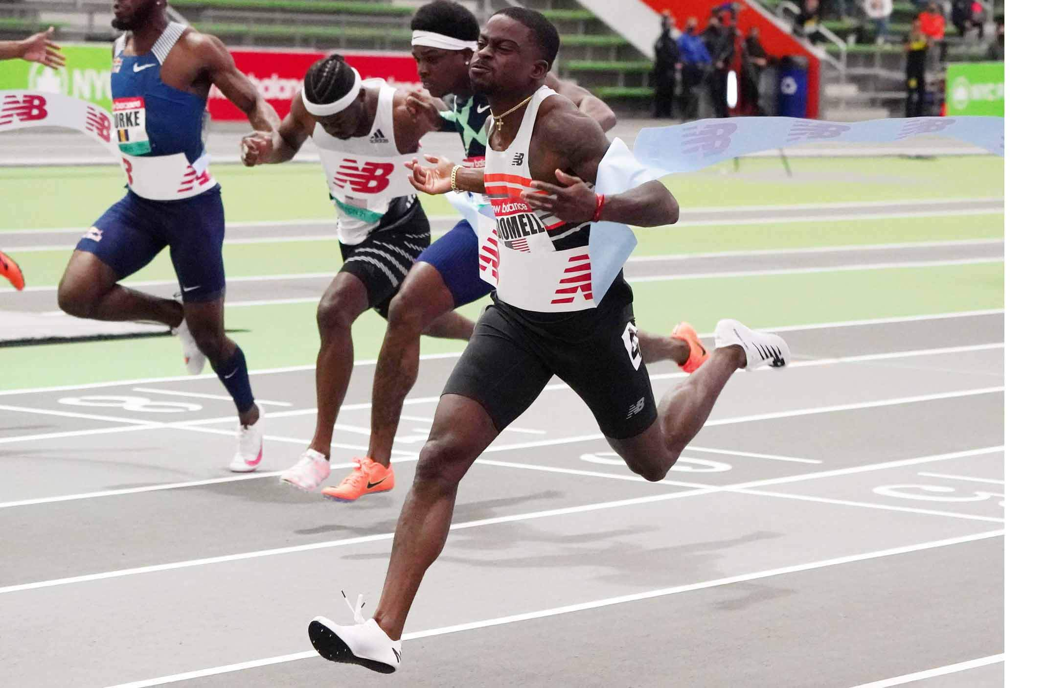Trayvon Bromell (USA) wins the 60m in 6.50 during the New Balance Indoor Grand Prix at Ocean Breeze Athletic Complex. From left are Mario Burke (BAR) and Brandon Carnes (USA) and Marvin Bracy (USA) and Bromell. - USA TODAY Sports