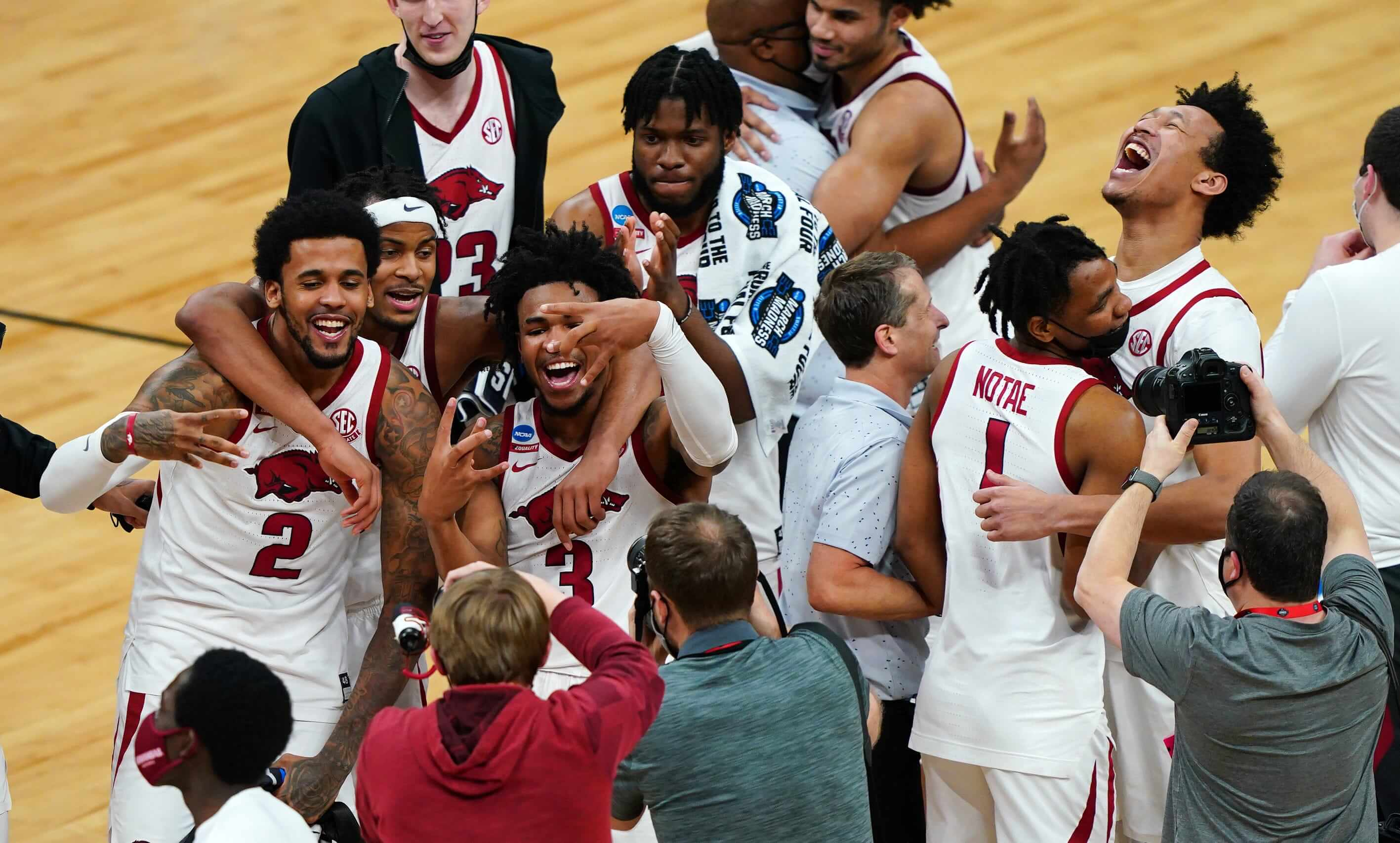 Arkansas Razorbacks celebrates for photographers after the Sweet Sixteen round of the 2021 NCAA Tournament on Saturday, March 27, 2021, at Bankers Life Fieldhouse in Indianapolis, Ind.
