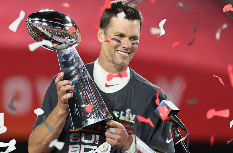 ampa Bay Buccaneers quarterback Tom Brady (12) hoists the Vince Lombardi Trophy after defeating the Kansas City Chiefs in Super Bowl LV at Raymond James Stadium.