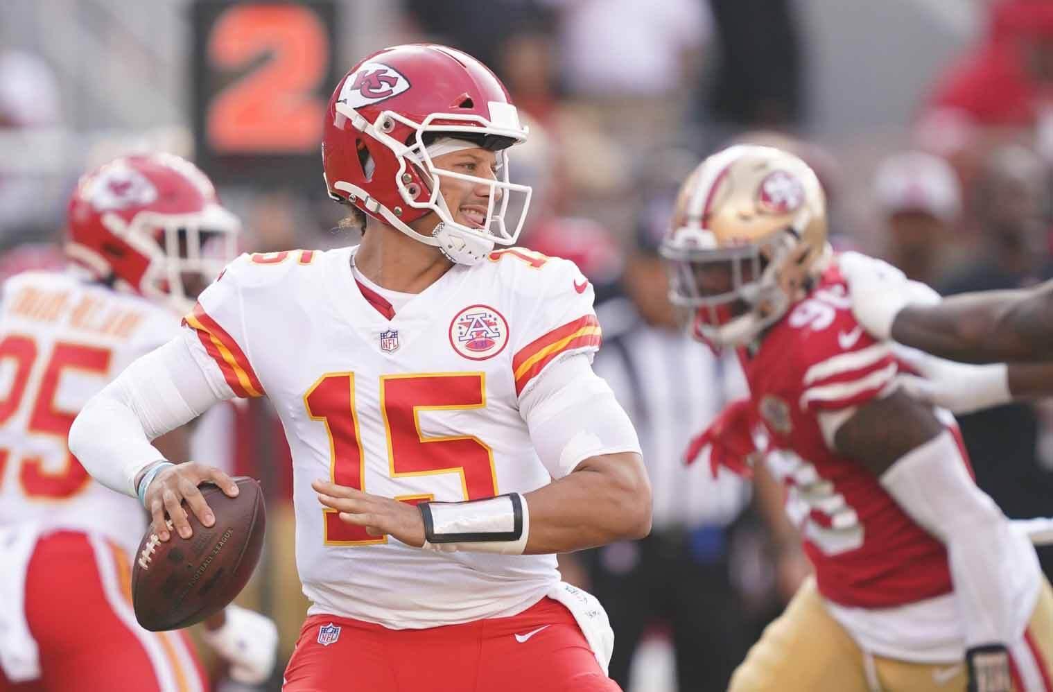Kansas City Chiefs quarterback Patrick Mahomes (15) passes the football against the San Francisco 49ers during the first quarter at Levi's Stadium.