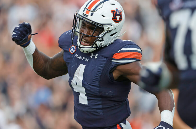 How To Bet - Auburn vs Arkansas Picks and Predictions: Tigers Too Fierce for Hogs