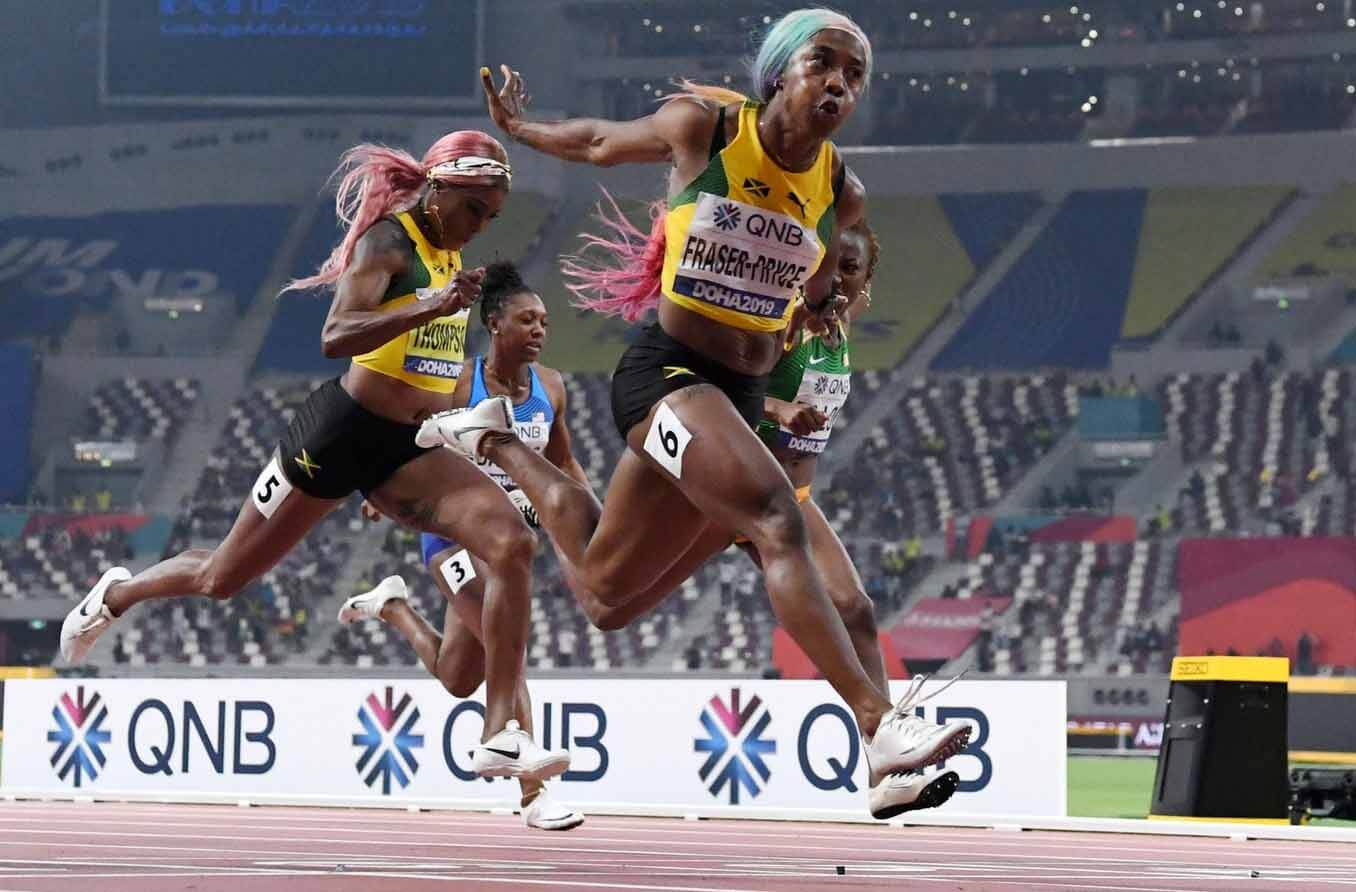 Shelly-Ann Fraser-Pryce (JAM) defeats Dina Asher-Smith (GBR), Elaine Thompson (JAM) and Marie-Josee Ta-Lou (CIV) to win the women's 100m in 10.71 during the IAAF World Athletics Championships at Khalifa International Stadium. - USA TODAY Sports