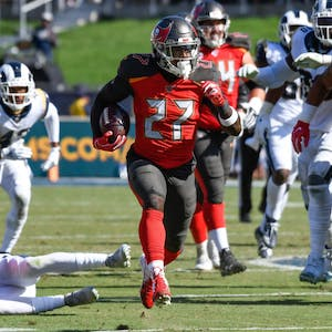 Tampa Bay Buccaneers running back Ronald Jones (27) runs through the Los Angeles Rams defense during the 2nd half at Los Angeles Memorial Coliseum on Sept 29, 2019. It is the one of the highest scoring games in NFL history.