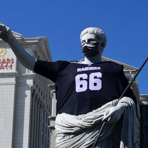 A statue at Caesars Palace Las Vegas wears a Las Vegas Raiders jersey.
