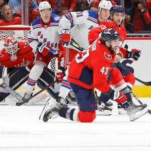 ew York Rangers defenseman Jacob Trouba (8) shoots the puck as Washington Capitals right wing Tom Wilson (43) defends during the first period at Capital One Arena.