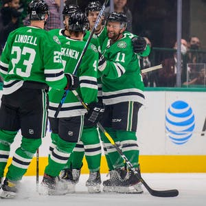 Dallas Stars defenseman Esa Lindell (23) and defenseman Miro Heiskanen (4) and left wing Michael Raffl (18) and center Luke Glendening (11) and right wing Denis Gurianov (34) celebrate a goal by Raffl against the Colorado Avalanche during the first period